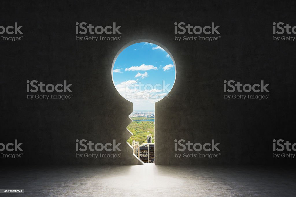 keyhole in concrete wall. New York City view in hole. stock photo