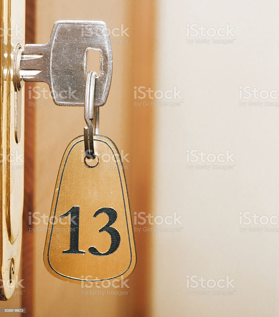 keyhole of room number 13 with key stock photo
