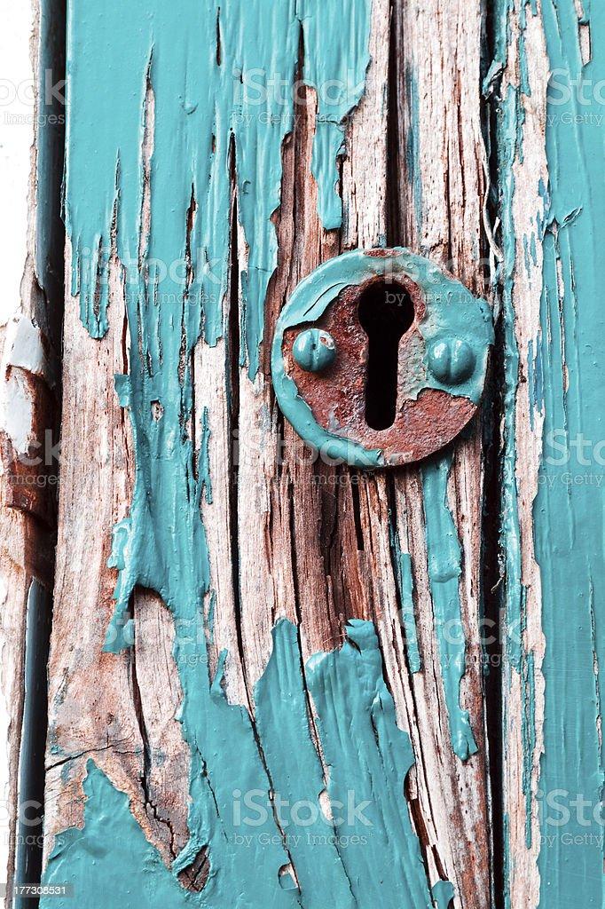 Keyhole on rotten wooden door royalty-free stock photo