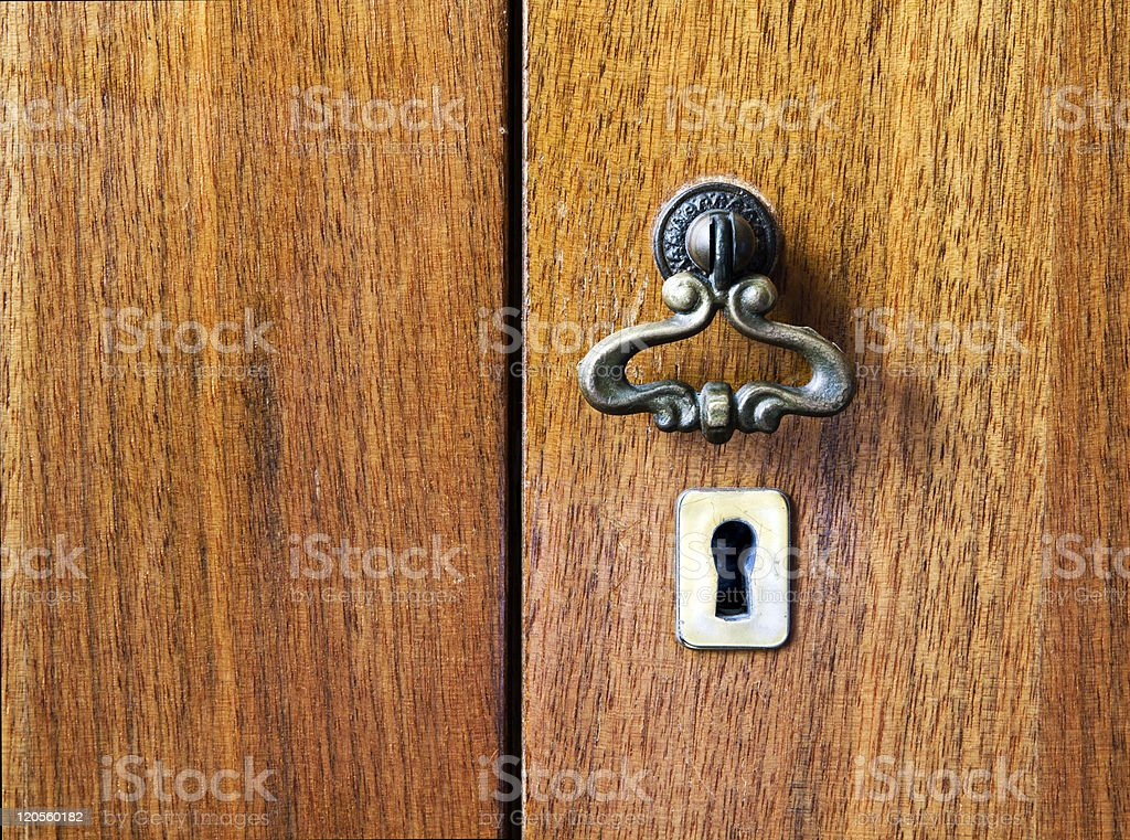 Keyhole. Wooden furniture royalty-free stock photo