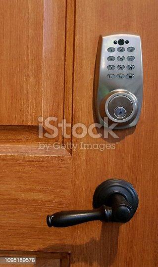 Front door with code entry instead of key.