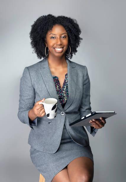 Keynote Speaker Preparing with Coffee and Tablet stock photo