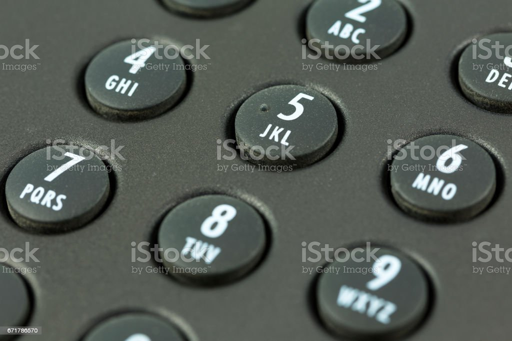 keypad with letter mapping of a black telephone stock photo
