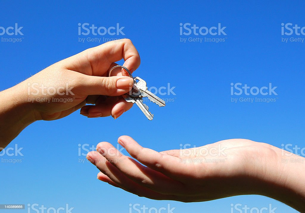 Keys and hands royalty-free stock photo