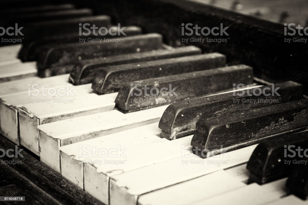 Keys from an old broken damaged piano royalty-free stock photo