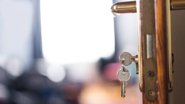 Keys from room hotel on the door stock photo
