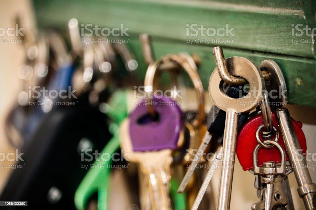 Keys hanging on hooks stock photo