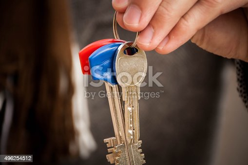 82186105 istock photo keys in hand 496254512