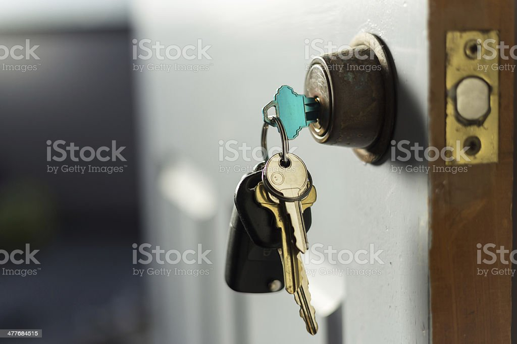 keys in the door stock photo
