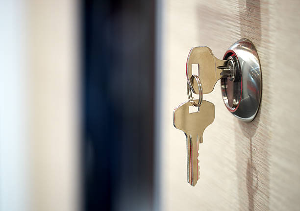 keys in the keyhole - key stock pictures, royalty-free photos & images