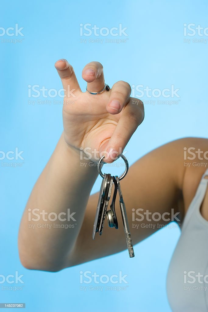 Keys in woman hand royalty-free stock photo