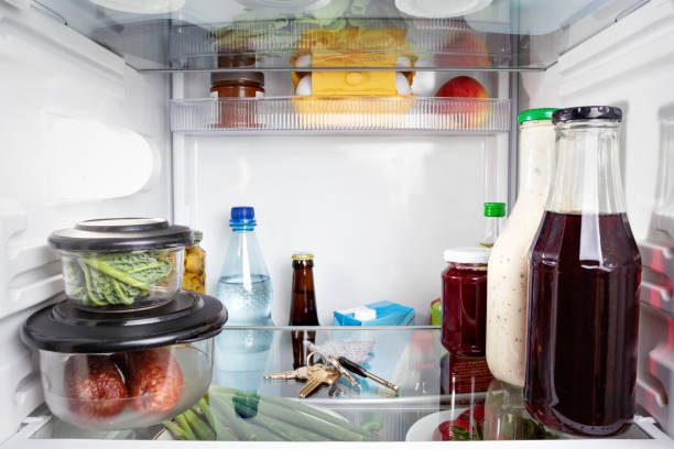 keys misplaced in a fridge - lost stock photos and pictures