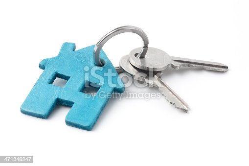 Keyring with a house and keys. House keys concept. Isolated on white.