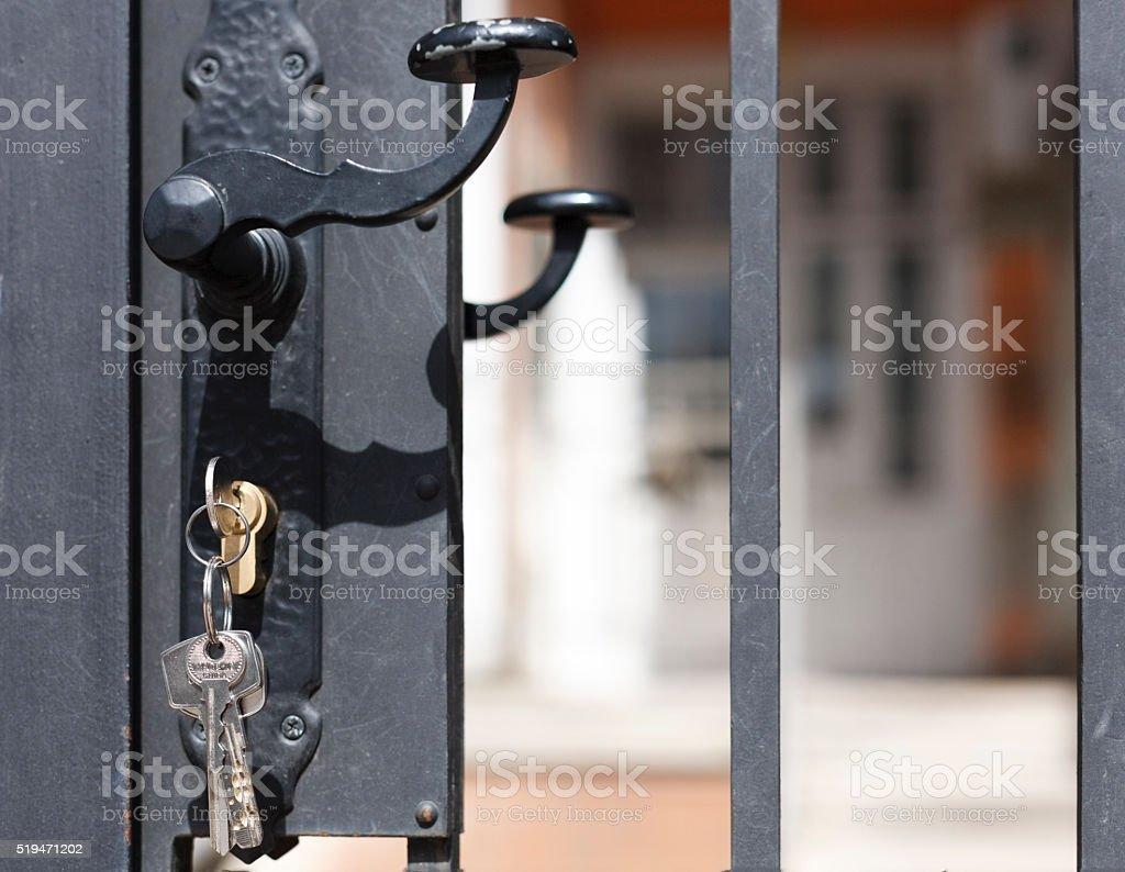 Keys on door stock photo