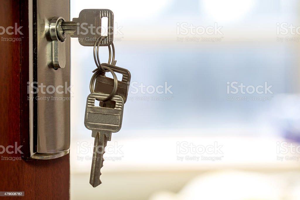 keys on the door stock photo