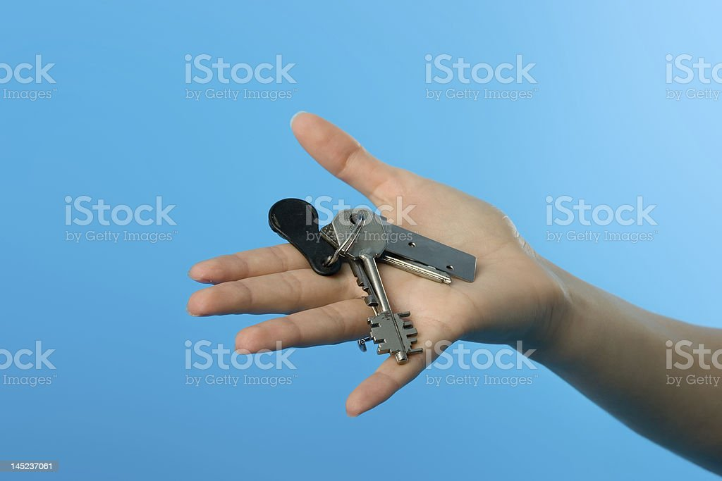 Keys on womans hand royalty-free stock photo
