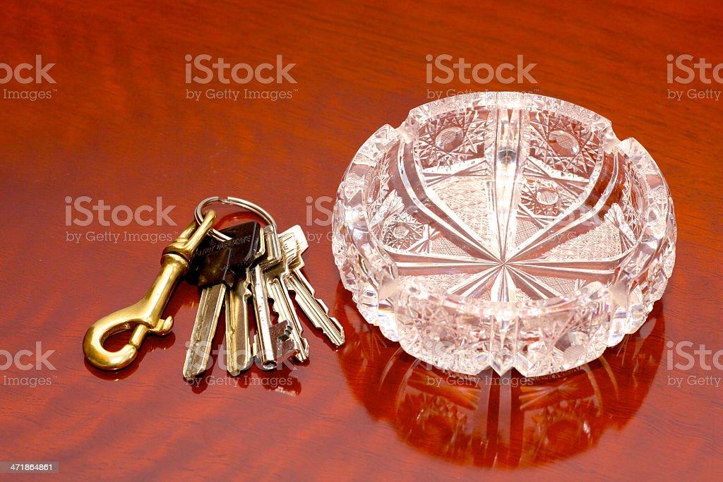 Keys to the office and  crystal ashtray royalty-free stock photo