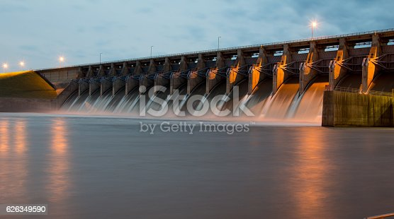 The Keystone Dam in Oklahoma with all the gates open and flowing a lot of water.  Shot at Twilight.