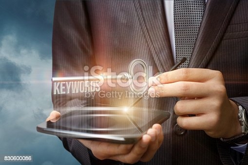 istock Keywords as key on the virtual screen. 830600086