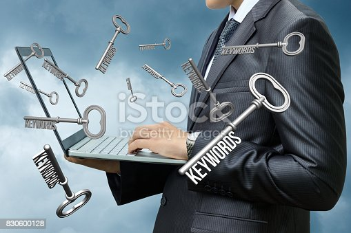 866680594 istock photo Keywords dials businessman on computer . 830600128