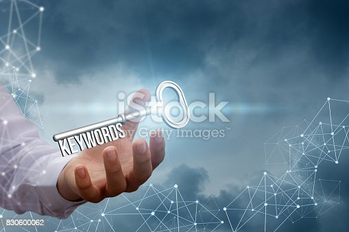 921148564istockphoto Keywords in the hand of a businessman on the background network. 830600062