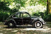 Hamburg, Germany - July 28, 2018: Black Oldtimer VW (Volkswagen beetle) Käfer in front of a park in Altona, Hamburg, Germany
