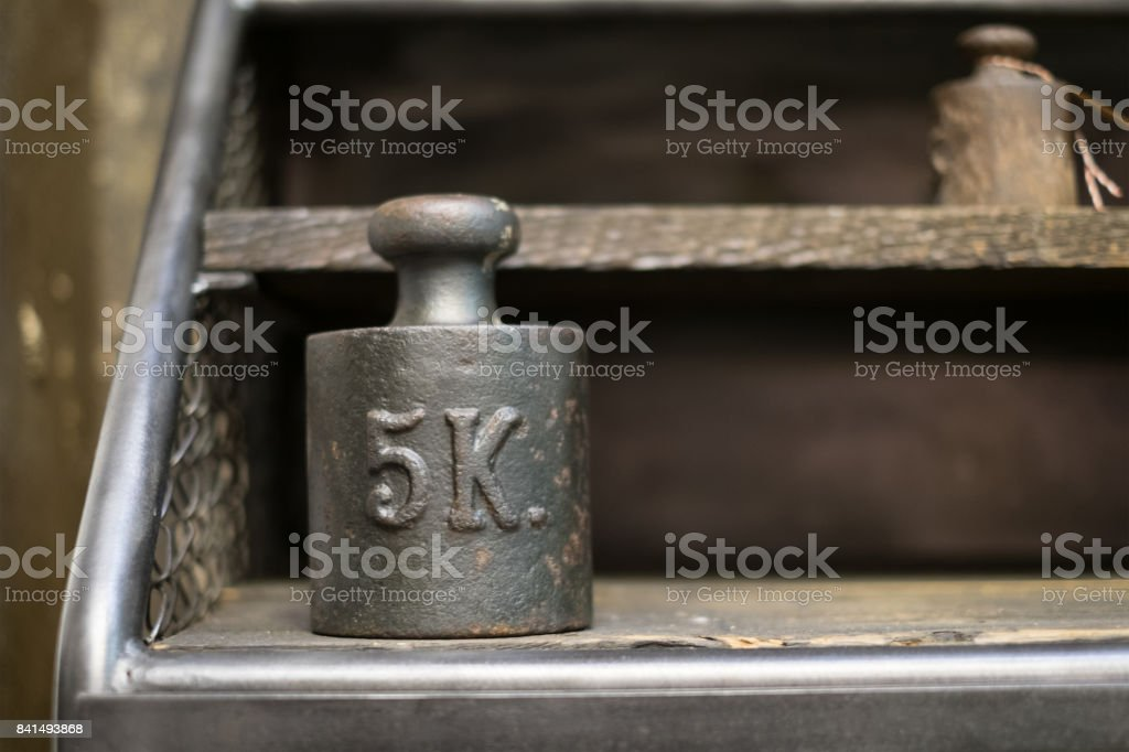 5 kg weights - old 5 kilogram weights on work bench stock photo