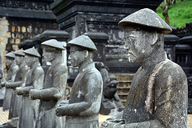 Khai Dinh Tomb, Vietnam Statues at tomb of Khai Dinh emperor in Hue, Vietnam khai dinh tomb stock pictures, royalty-free photos & images