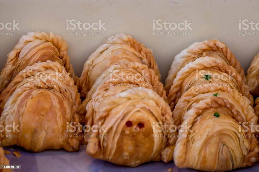 Khanom Pun Klib or Small Curry Stuffed Puff is small pir consisting of specialised curry with chicken and potatoes in deep-fried or baked pastry shell. Thai style. stock photo