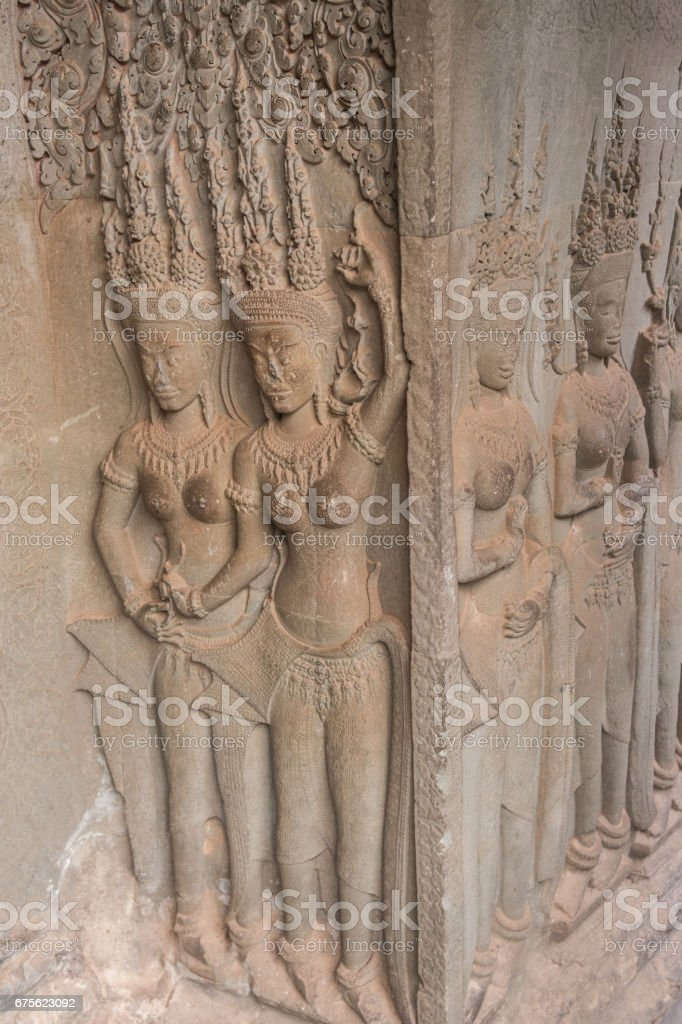 Khmer classical nymphs  and dancers shown in stone - An Apsara (also spelled as Apsarasa) in Angkor Wat temple, Siem Reap, Cambodia. royalty-free stock photo