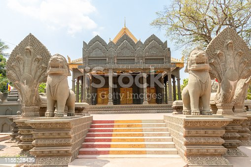 Buddhist temple in Khnat close to Siem Reap in Cambodia with modern cast concrete effigies of Hindu gods replicating those found close by at Angkor Wat archeological area