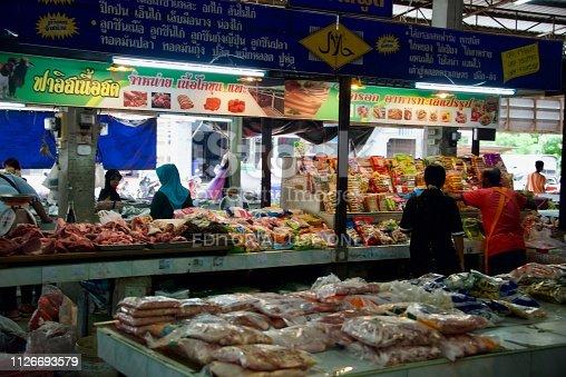 Amphoe Takua Thung, Phang-nga, Thailand – December, 18, 2017; unidentified people at the Khok Kloi Fresh Market in Amphoe Takua Thung, Phang-nga, Thailand
