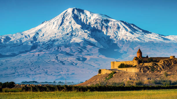 Khor Virap Monastery and Mt. Ararat Majestic snowcapped Mt. Ararat and monastery Khor Virap, Armenia armenia country stock pictures, royalty-free photos & images