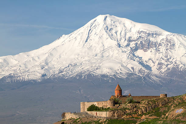 Khor Virap Monastery in Artashat, Armenia. Artashat, Armenia - April 27, 2015: Khor Virap Monastery and the Mount Ararat, in Armenia, with the logo of the the centennial of the Armenian Genocide, on the side of the mountain, representing a purple flower. armenian genocide stock pictures, royalty-free photos & images