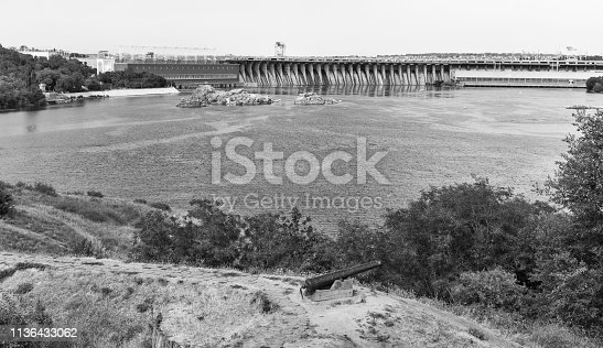 Scenic view from the island of Khortytsia with Zaporozhskaya Sich to the Dnieper River and Dnipro hydroelectric power plant dam in Zaporizhia, Ukraine. Black ans white.
