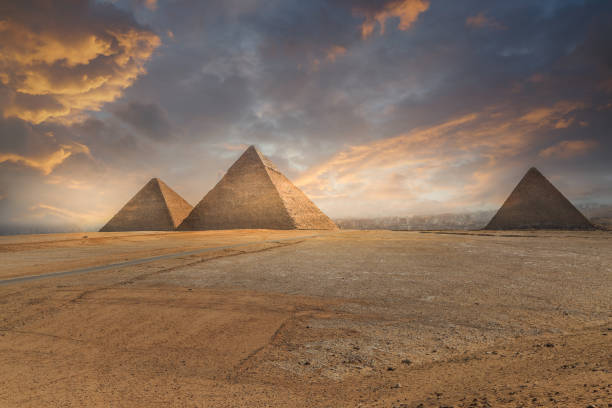 khufu pyramid and empty square , cairo, egypt - pyramid stock photos and pictures