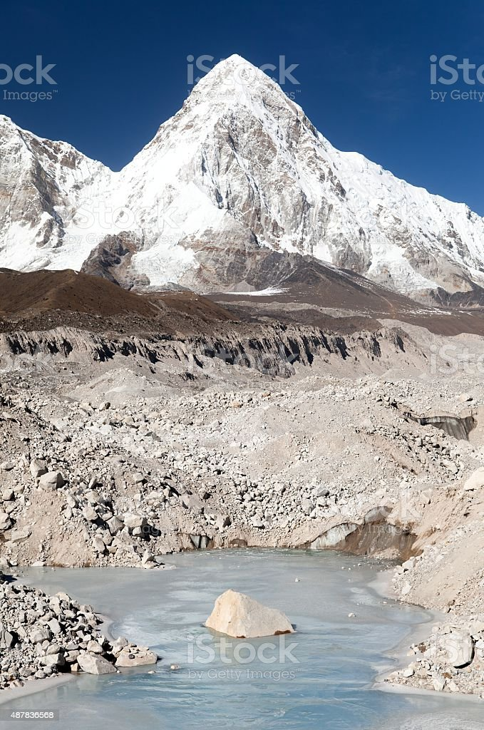 Khumbu glacier with lake and Pumori peak stock photo