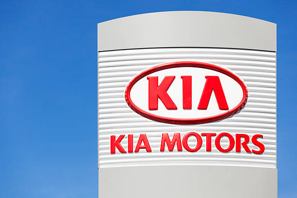 Kia Motors Sign Above Dealership stock photo