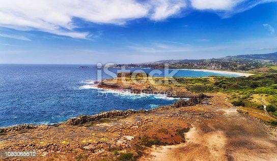 Geological Bombo Quarry of hexagonal basalt rocks on Australian Pacific coast of Kiama town on a sunny summer day.