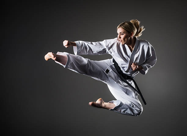 kick in jump - karate stock photos and pictures