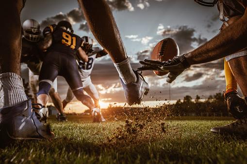 istock Kick off on American football match at sunset! 891304196
