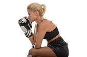 Female kickboxer taking a break from her workout.