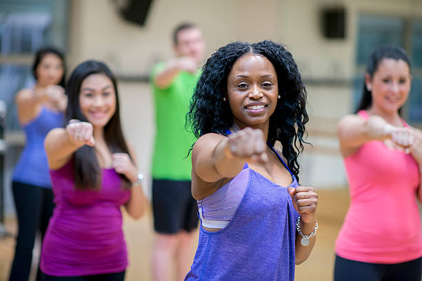 kickboxing class at the gym - aerobics stock photos and pictures