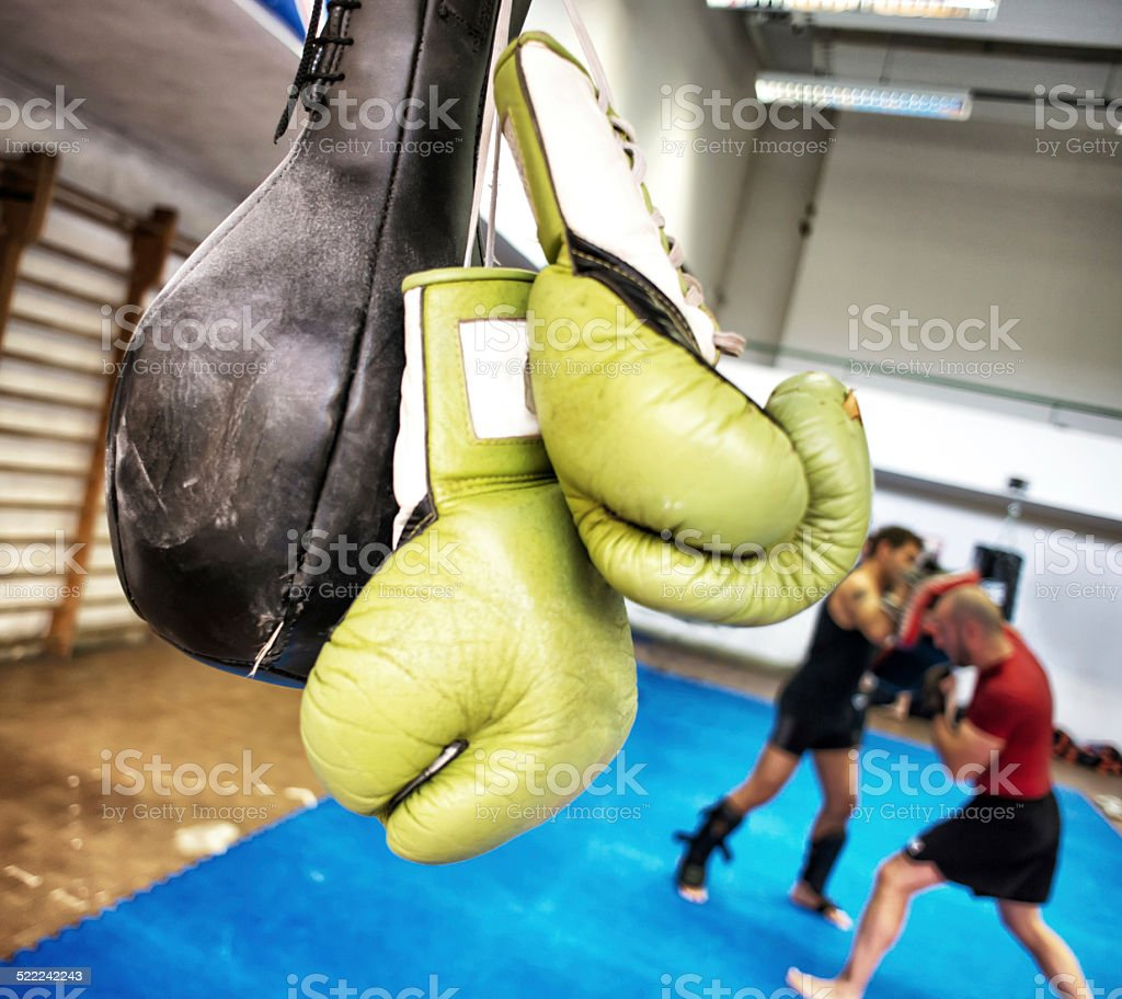 Kickboxing Training. Boxing Glove and Punching Ball in Foreground stock photo