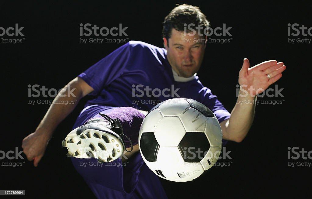 Kicking a Football royalty-free stock photo