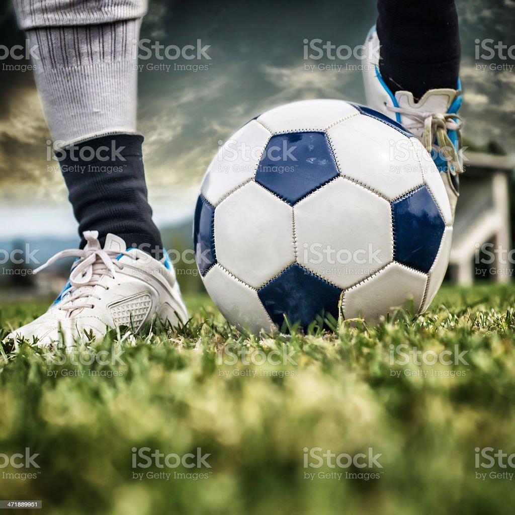 kicking a Soccer Ball royalty-free stock photo