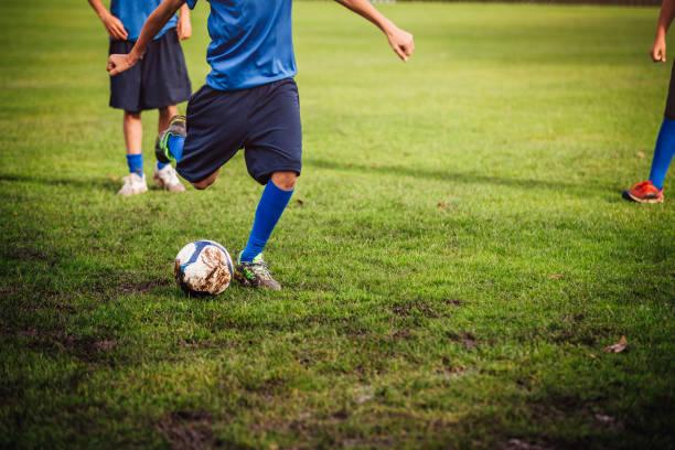 Kicking a Soccer Ball stock photo