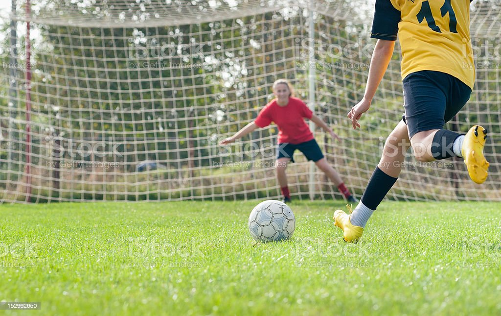 kicking and  Defending in soccer royalty-free stock photo