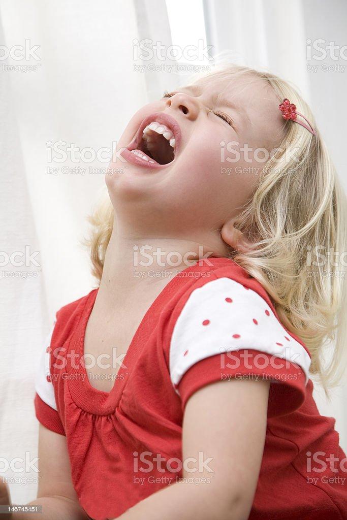 kicking and screaming stock photo