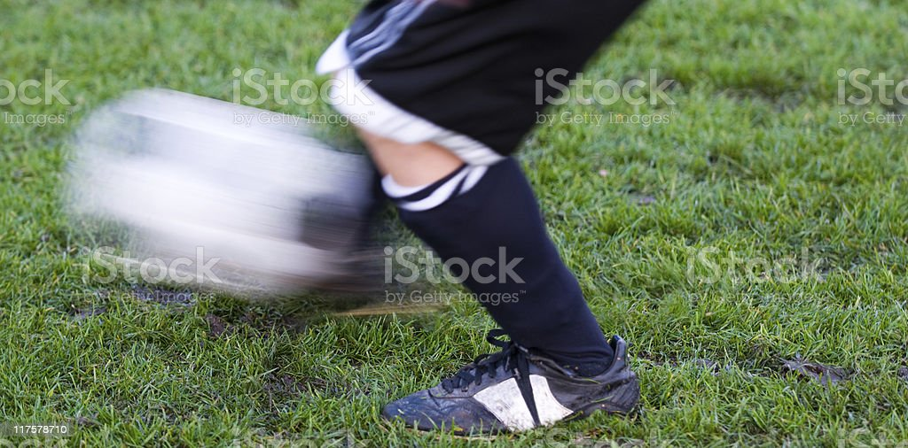 Kicking ball gets kick with lots of motion royalty-free stock photo